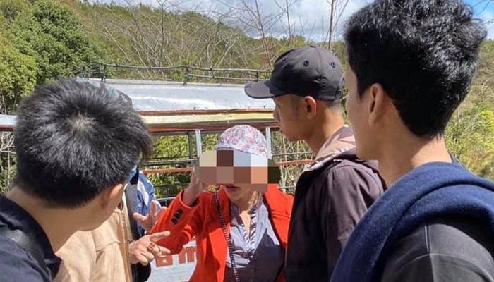 Người phụ nữ áo cam hành hung du khách Thái Lan